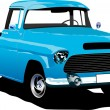 Old blue pickup with badges removed. - Stock Photo