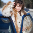 Stock Photo: Womwith her car in winte