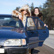 Two women with car in winter — Stock Photo #5429170