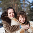 Two smiling girls in winter — Stock Photo #5429183