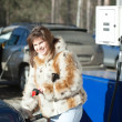Woman filling her car — Stock Photo #5429194