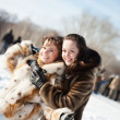 Girls plays in winter park — Stock Photo