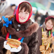 Girls with pancake during Shrovetide — Stock Photo #5429357