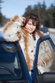 Woman with her car in winte — Stock Photo