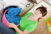 Woman putting clothes in to washing machine — Stock Photo