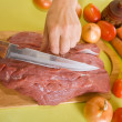Cook hands cutting beef — Stock Photo #5430126