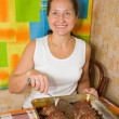 Woman with cooked stuffed beef — Stock Photo