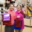 Stock Photo: Women with purchases in underwear shop