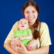 Mother holding young baby — Stock Photo #5430835