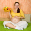 Healthy pregnant woman with  fruits — Stock Photo