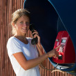 Girl on the pay phone — Stockfoto