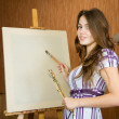 Painter near easel — Stock Photo