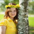 Girl in  flowers wreath  near birch - Stock Photo