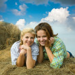 Girls on hay in summer — Stock Photo #5431831