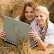 Stock Photo: Country girls with notebook