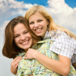 Girls together against sky — Stock Photo