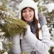 Woman near pine tree in winter — Stok fotoğraf