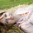 Girl on fresh hay — Stockfoto