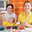 Family painting eggs for Easter — Stock Photo #5432206