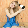Girl using hairdryer — Stock Photo