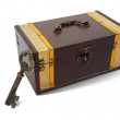 Vintage  key and treasure chest - Stock Photo