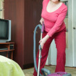 Woman cleaning with vacuum cleaner — Stock Photo #5434631