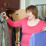 Mature woman at wardrobe — Stock Photo #5434634