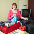 Woman   packing Suitcase — Stock Photo