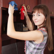 Stock Photo: Girl cleans furniture indoor