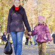Mother with daughter is walking — Stock Photo