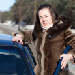 G woman near her car in winter road — Stock Photo