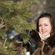 Stock Photo: Woman near pine tree in winter