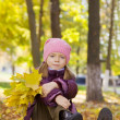 Stock Photo: Girl in autumn park