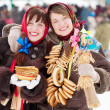 Happy girls with pancake during Shrovetide — Stock Photo #5434934
