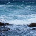 Постер, плакат: Sea wave breaking against coast rock
