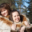Happy girls in winter park — Stock Photo #5435178