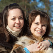 Two smiling girls in winter — Stock Photo #5435185