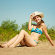 Girl sunbathing on beach — Stock Photo