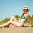 Sunbathing girl in bikini - Stockfoto