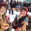 Happy girls eating pancake during Shrovetide — 图库照片