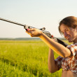 Girl aiming a pneumatic rifle — Stock Photo #5435237