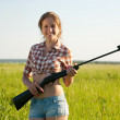 Girl holding pneumatic air rifle — Stockfoto #5435240