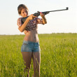 Girl with air rifle — Stock Photo #5435241