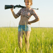 Stock Photo: Girl with air rifle