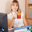 Royalty-Free Stock Photo: Businesswoman with cup of tea   in office
