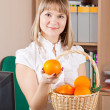Royalty-Free Stock Photo: Businesswoman with basket of orange