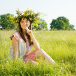 Girl traditional clothes on meadow — Stockfoto