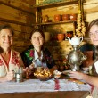 Women near russian samovar — Stock Photo #5435892