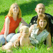 Family on grass — Stock Photo