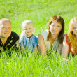 Stock Photo: Family lying on grass